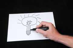 Drawing on a White Paper Royalty Free Stock Photography