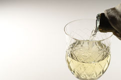 Drawing white wine. In a crystal chalice Stock Photography