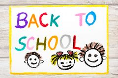Drawing: Word BACK TO SCHOOL and happy children. First day at school. Stock Photos