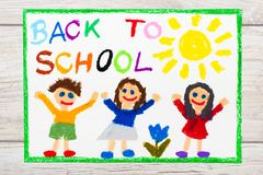Drawing: Word BACK TO SCHOOL and happy children. First day at school. Photo of  colorful drawing: Word BACK TO SCHOOL and happy children. First day at school Royalty Free Stock Photos