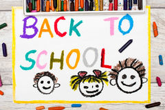 Drawing: Word BACK TO SCHOOL and happy children. Photo of colorful drawing: Word BACK TO SCHOOL and happy children. First day at school Stock Images
