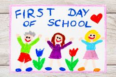 Drawing: Word FIRST DAY OF SCHOOL and happy children Royalty Free Stock Image