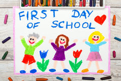 Drawing: Word FIRST DAY OF SCHOOL and happy children. Photo of colorful drawing: Word FIRST DAY OF SCHOOL and happy children Royalty Free Stock Image