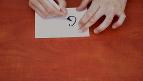 Drawing word Go. Interlocutor writes note with the word Go stock video
