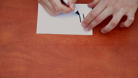 Drawing word Hush. Interlocutor writes note with the word Hush stock footage