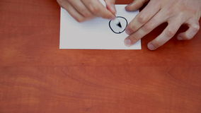 Drawing word On. Interlocutor writes note with the word On stock footage