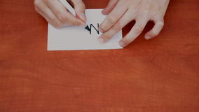 Drawing word NO. Interlocutor writes note with the word NO stock video footage