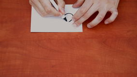 Drawing word Order. Interlocutor writes note with the word Order stock video footage