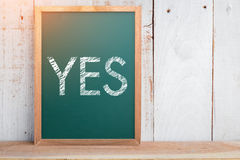 Drawing of word yes on chalkboard Royalty Free Stock Photos