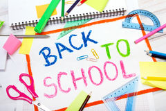 Drawing with words `back to school` and school accessories. Colorful drawing with words `back to school` and school accessories Stock Photo