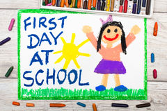 Drawing: Words FIRST DAY AT SCHOOL and happy girl. Photo of colorful drawing: Words FIRST DAY AT SCHOOL and happy girl Royalty Free Illustration