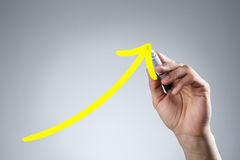 Drawing yellow arrow Stock Photo