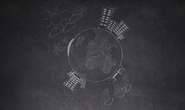 Drawingaround the world on wall. Lifestyles  Education  School travel background Stock Image