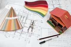 Drawings on the architect`s engineering desk Stock Images
