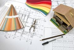 Drawings on the architect`s engineering desk Stock Image