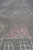 Drawings on asphalt Stock Photos