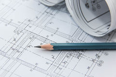 Drawings of the building and pencil. Royalty Free Stock Photo