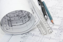 Drawings of the building and pencils. Royalty Free Stock Image