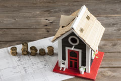 Drawings for building  and small wooden house Royalty Free Stock Photo