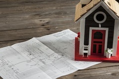 Drawings for building  and small wooden house Royalty Free Stock Photography