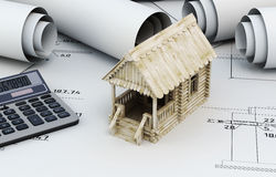 Drawings for building and small wooden house with calculator Stock Image