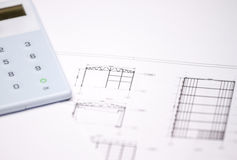 Drawings and calculator Royalty Free Stock Images
