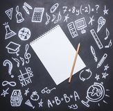 Drawings on the chalkboard on the new academic year, fall, school supplies, drawn around a notebook with a pencil, place  text, Royalty Free Stock Photo