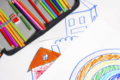 Drawings and colored pencils Royalty Free Stock Photo