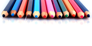Drawings and  crayons. Children's drawings and colourful crayons Stock Images