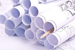 Drawings and drawings rolled in a tube Royalty Free Stock Photo