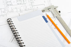 Drawings and exercise book. With steel ruler Royalty Free Stock Photos