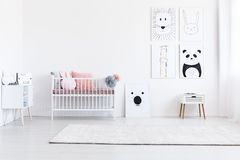 Drawings gallery in girl`s bedroom. Animal drawings gallery in girl`s bedroom with pink pillows on bed and white cupboard royalty free stock photo