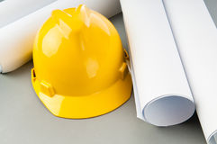 Drawings and hard hat Stock Image