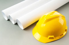 Drawings and hard hat Royalty Free Stock Photography
