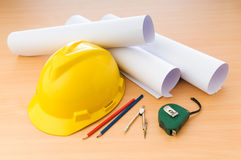 Drawings and hard hat Royalty Free Stock Photo