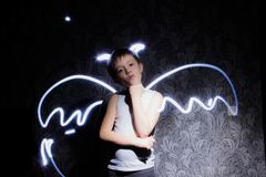 Drawings with light angel or demon wings royalty free stock photo