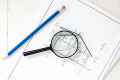 Drawings with pencil and magnifier Royalty Free Stock Images