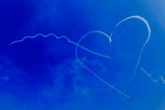 Drawings of smoke in the sky, heart shaped 1 Stock Images