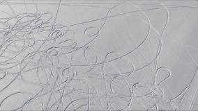 Drawings in the snow. Video of drawings from tracks of snowmobiles and cars on snow stock footage