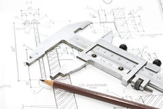 Drawings and tools. Architecture drawings and working tools Royalty Free Stock Photography