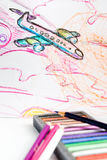 Drawn airplane. Alongside crayons, pastel Stock Image