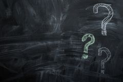 Drawn on the blackboard question marks Stock Images