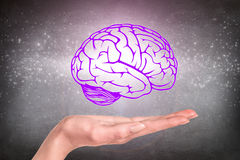 Drawn brain hovered over the human hand Stock Photo