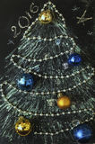Drawn in chalk on a black background Christmas tree with toys.  Royalty Free Stock Photos