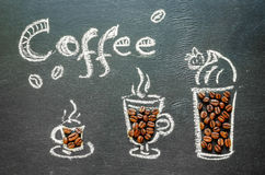 Drawn with chalk cup of coffee with coffee beans and coffee insc Stock Photos