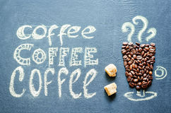 Drawn with chalk cup of coffee with coffee beans and coffee insc Royalty Free Stock Images