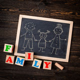 Drawn on a chalkboard family Stock Photos