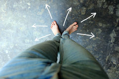 Drawn Direction Arrows, Female Barefeet on the Concrete Background. Great For Any Use Stock Images