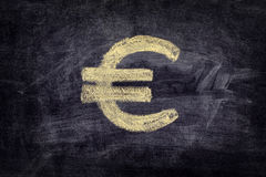 Drawn euro sign on black chalkboard background Stock Image
