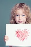 The drawn heart. Beautiful girl with drawn heart Stock Images